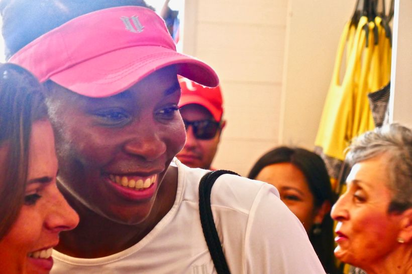 Venus Williams taking a selfie with a fan at the Miami Open.