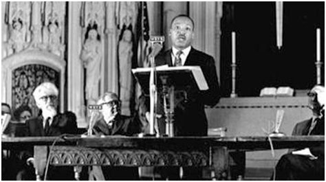 Martin Luther King speaking at Riverside Church, April 4, 1967.  Rabbi Abraham Joshua Heschel is at left.