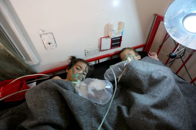 Children get treatment at a hospital after Assad forces attacked Idlib, Syria on