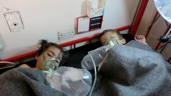 IDLIB, SYRIA - APRIL 4: Children get treatment at a hospital after Assad Regime forces attacked with chlorine gas to Khan Shaykhun town of Idlib, Syria on April 4, 2017.    (Photo by Mohammed Karkas/Anadolu Agency/Getty Images)