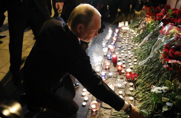 Russia's President Vladimir Putin lays flowers in memory of the St Petersburg Metro explosion victims...