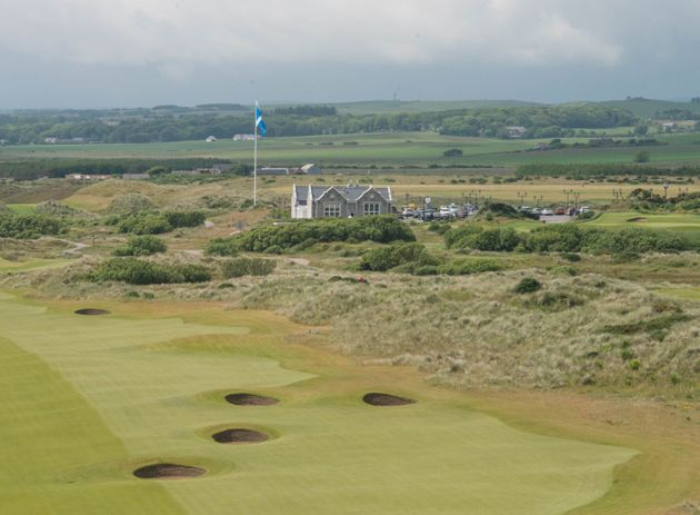 Trump's International Golf Links course clubhouse is pictured behind the 18th hole, north of Aberdeen...