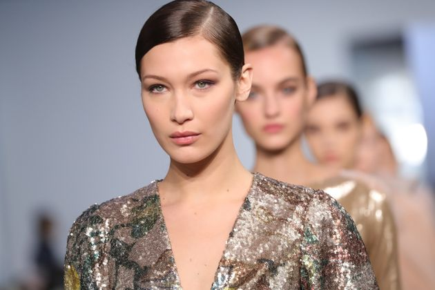 Bella Hadid walks the runway at Carolina Herrera during New York Fashion