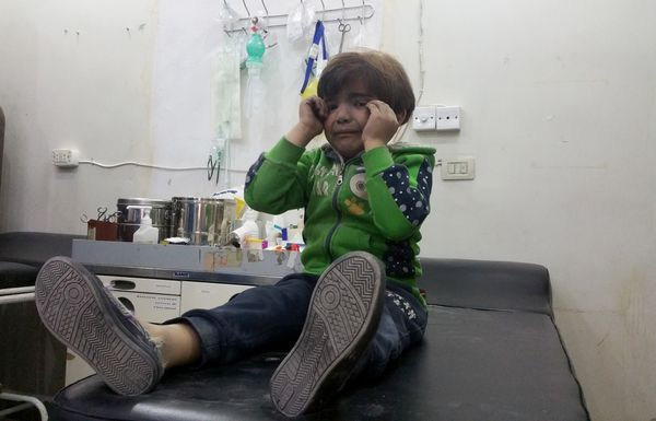 A child gets treatment at a hospital after Assad regime forces attacked with suspected chlorine gas.