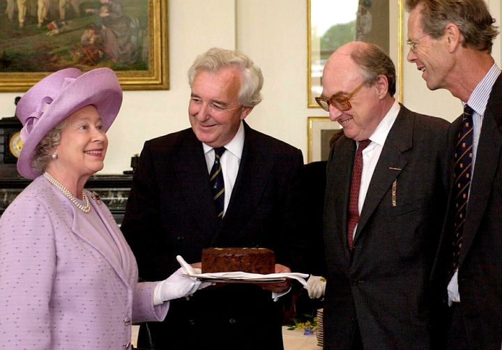 The queen presenting a Dundee Cake.