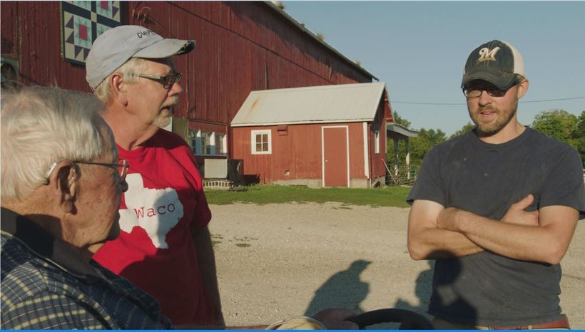 Three generations of Lauderdales discuss their day on the farm. From left to right: George Lauderdale, Gene Lauderdale, Dan L