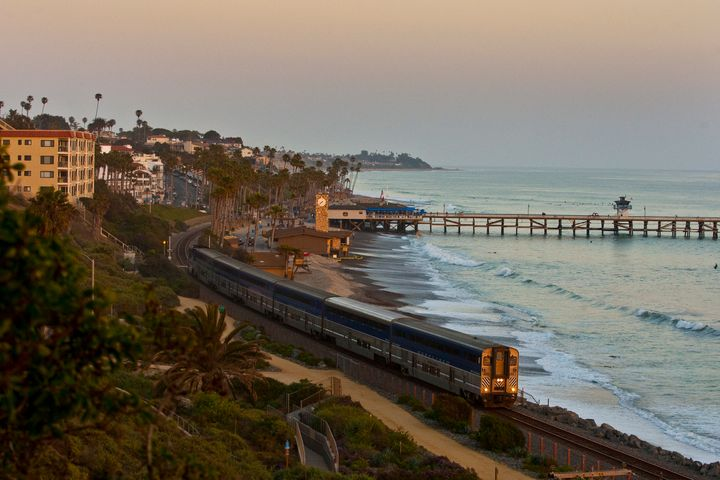 The Pacific Surfliner rolls through San Clemente at dusk.