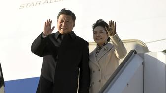 China's President Xi Jinping and his wife, Peng Liyuan, arrive at Helsinki Airport in Vantaa, Finland April 4, 2017. Lehtikuva/Antti Aimo-Koivisto/via REUTERS ATTENTION EDITORS - THIS IMAGE WAS PROVIDED BY A THIRD PARTY. FOR EDITORIAL USE ONLY. NO THIRD PARTY SALES.FINLAND OUT. NO COMMERCIAL OR EDITORIAL SALES IN FINLAND