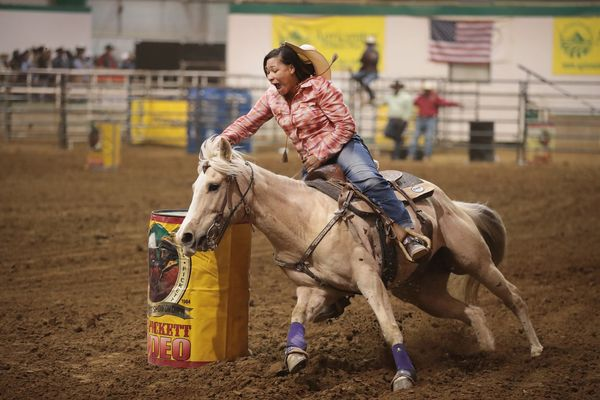Danesha Henderson participates in the barrel race competition.