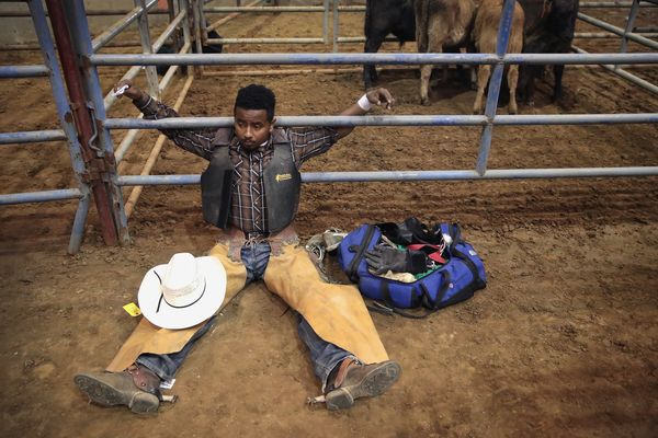 Bull rider Anthony Monts Jr. stretches before his ride.
