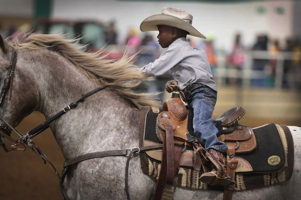 Harrel Williams Jr. competes in the junior barrel racing event.