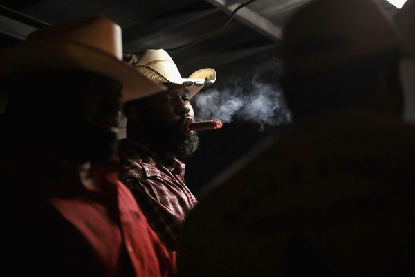 Cowboys relax at a late-night barbeque following a day of competition.