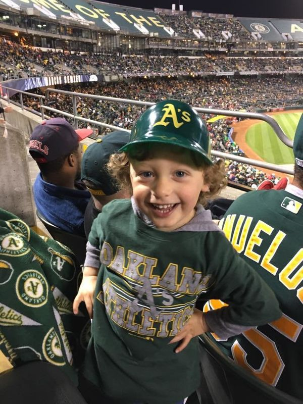 """This kid had a great time at opening day! Go A's!"""
