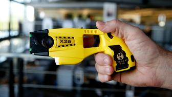 The Taser X26 electronic weapon is displayed for a photograph at the Taser International Inc. manufacturing facility in Scottsdale, Arizona, U.S., on Wednesday, April 22, 2015. Taser International Inc. is scheduled to release earnings figures on April 30. Photographer: Patrick T. Fallon/Bloomberg via Getty Images