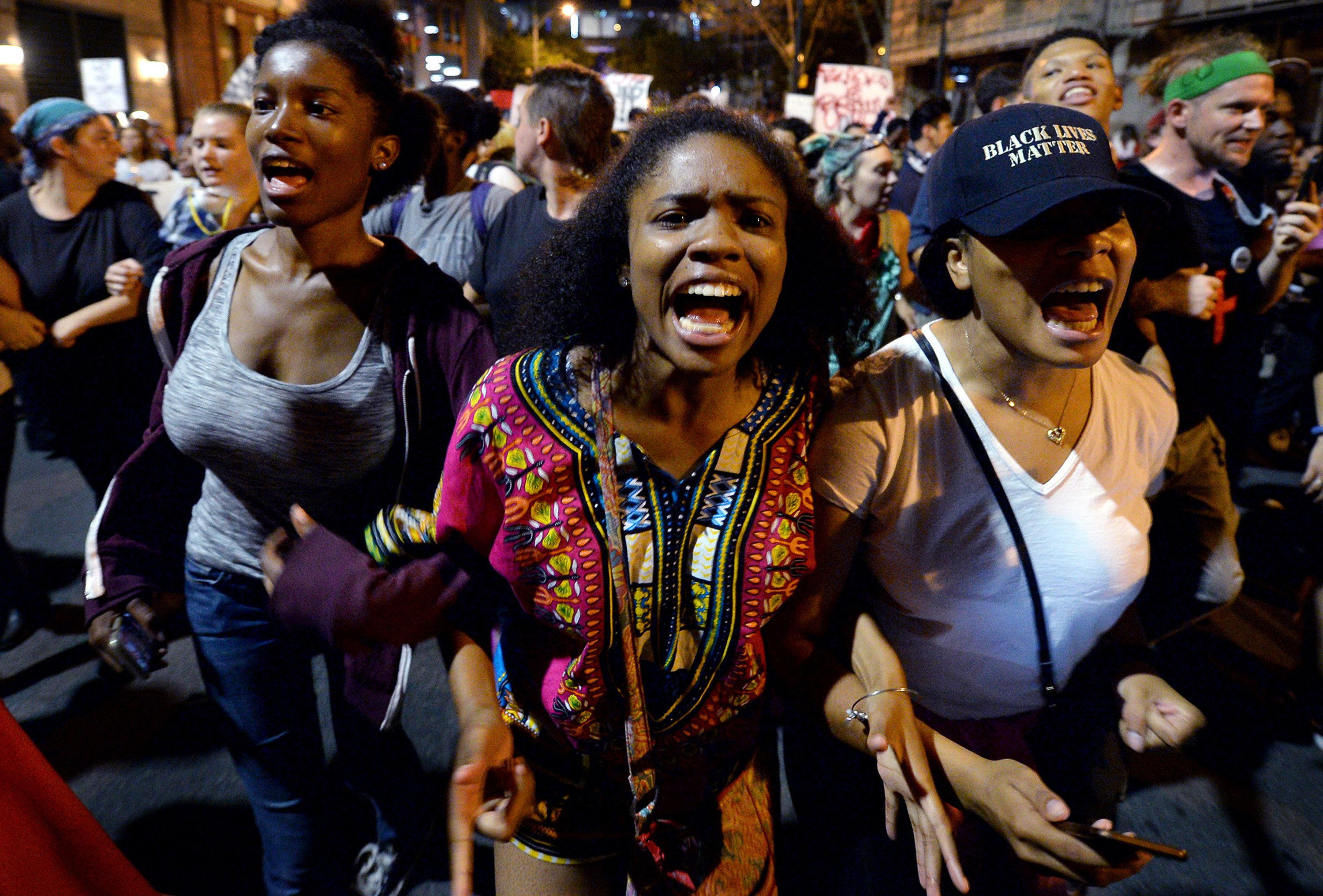 Protesters chant 'Black Lives Matter' as they march throughout the city of Charlotte, N.C., on Friday, Sept. 23, 2016, as demonstrations continue following the shooting death of Keith Scott by police earlier in the week. (Jeff Siner/Charlotte Observer/TNS via Getty Images)