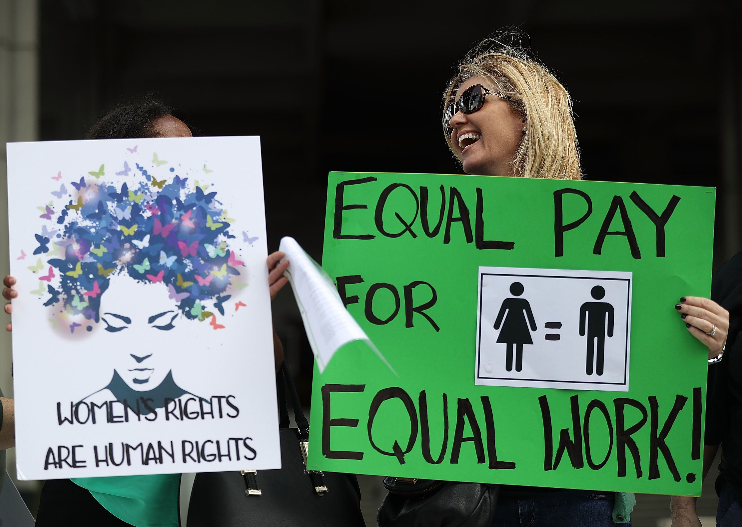 FORT LAUDERDALE, FL - MARCH 14:  Elana Goodman joins with other protesters to ask that woman be given the chance to have equal pay as their male co-workers on March 14, 2017 in Fort Lauderdale, Florida. The protest was held as the legislation in the state of Florida looks at passing the Helen Gordon Davis fair pay protection act that would strengthen state laws in terms of equal pay.  (Photo by Joe Raedle/Getty Images)