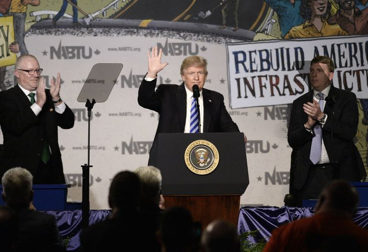 President Donald Trump speaks at the North America's Building Trades Unions national conference at the Washington Hilto