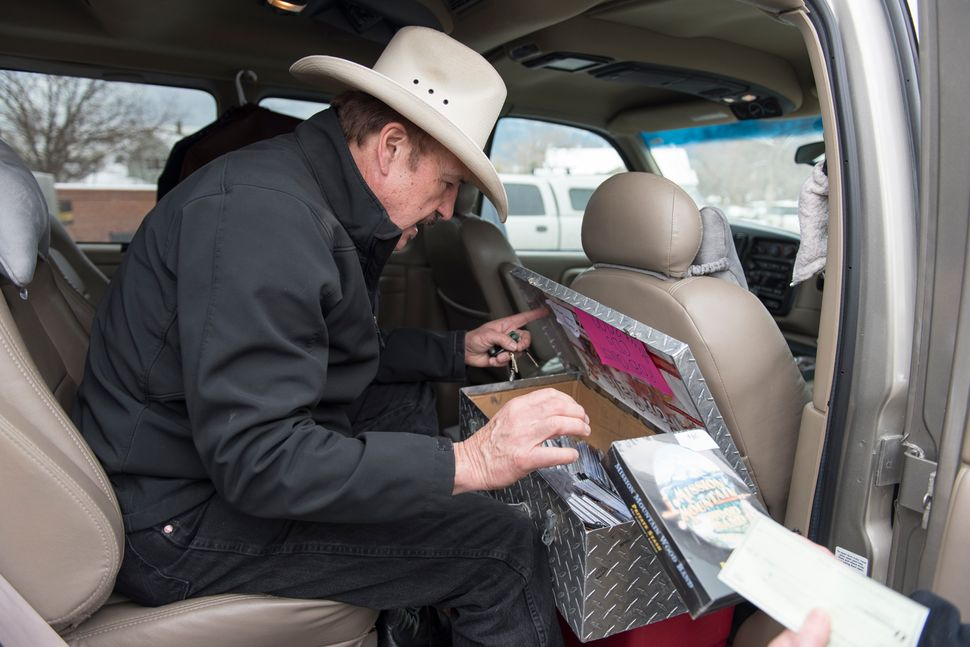 Rob Quist sells a few of his music CDs after a campaign stop on March 10 in Livingston, Montana.