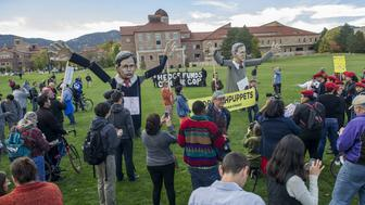 "Students and protesters hold puppets of U.S. Republican presidential candidates Jeb Bush (R) and Marco Rubio as they gather at the ""Free Speech Zone,"" located at the University of Colorado's Business Field, while candidates gather across the street for a forum held by CNBC before the U.S. Republican presidential candidates debate in Boulder, Colorado, October 28, 2015. REUTERS/Evan Semon"