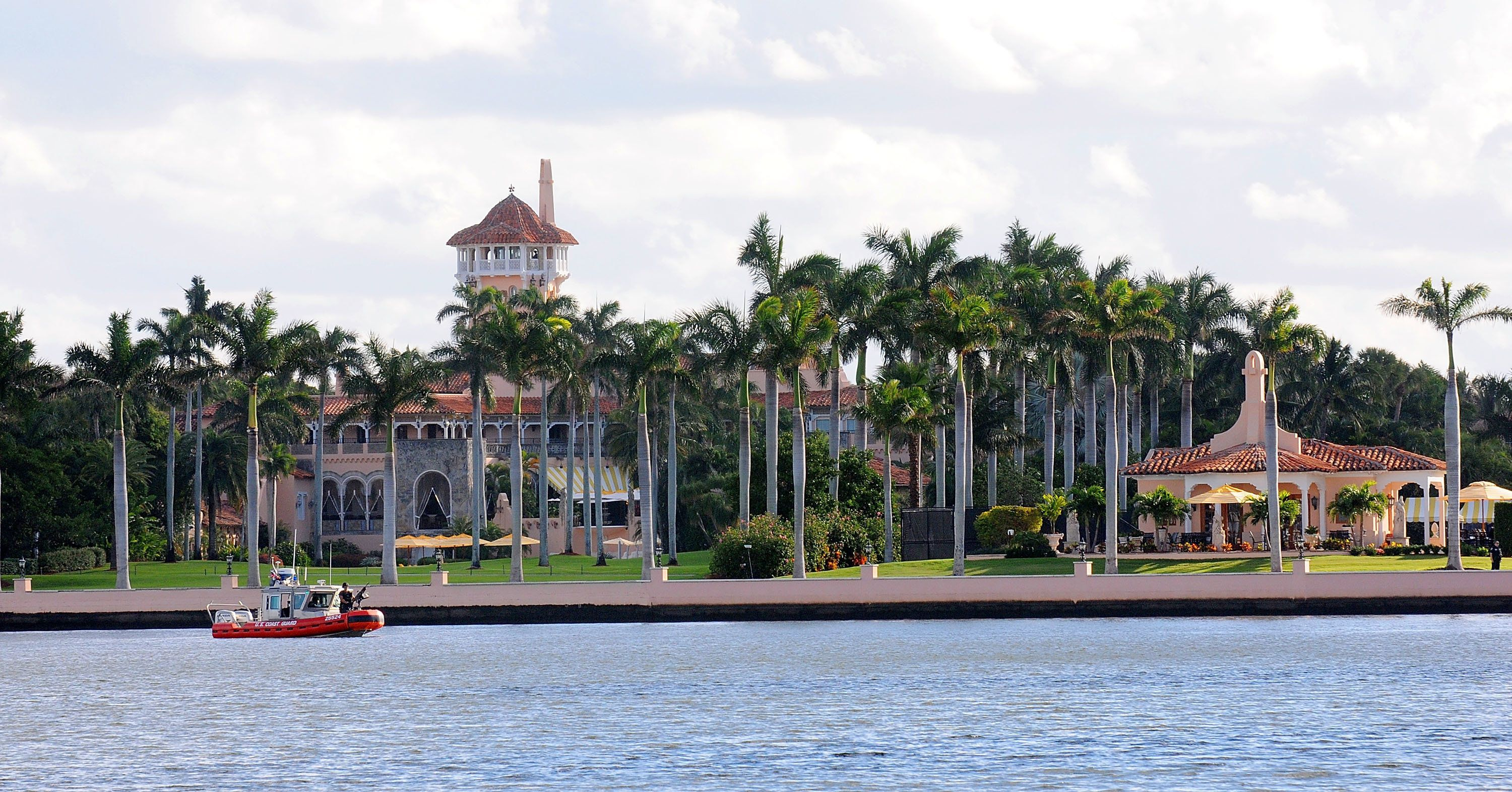 PALM BEACH, FL - NOVEMBER 23:  A US Coast Guard boat passes through the Mar-a-Lago Resort where President-elect Donald Trump will be spending Thanksgiving  on November 23, 2016 in Palm Beach, Florida.  The Trump family has spent many of their holidays at their South Florida home and security is expected to be tight in the area. (Photo by Gerardo Mora/Getty Images)