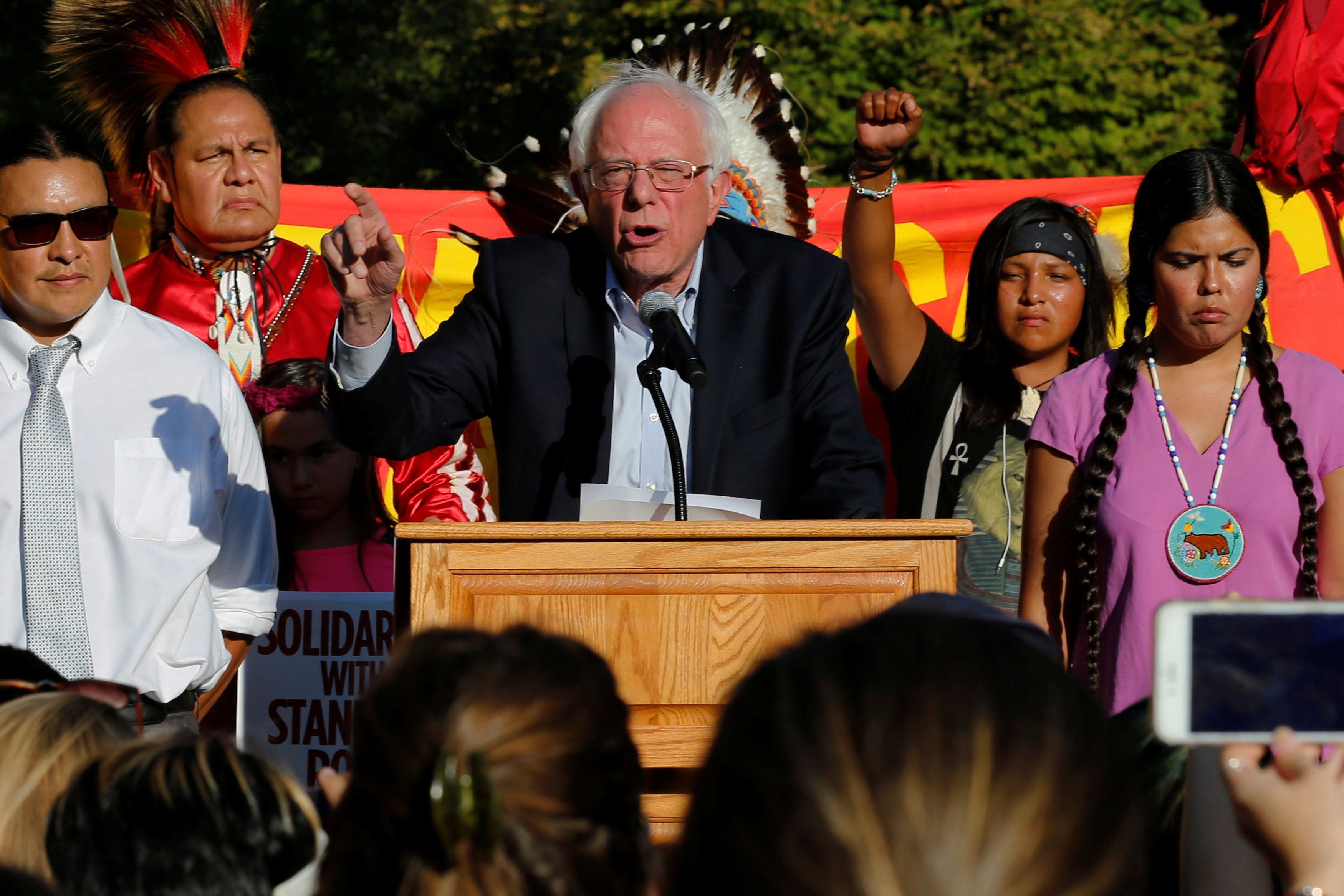 Former Democratic presidential candidate Senator Bernie Sanders (I-VT) (C) speaks at a rally with Native American activists to call on President Barack Obama to stop the Dakota Access Pipeline, in front of the White House in Washington, U.S. September 13, 2016. REUTERS/Jonathan Ernst