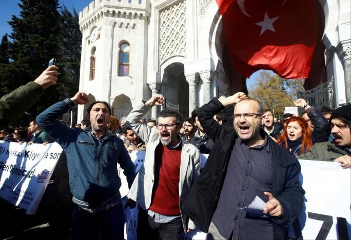 Demonstrators protest the purge of thousands of education staff in front of  Istanbul University at Beyazit square in Istanbu