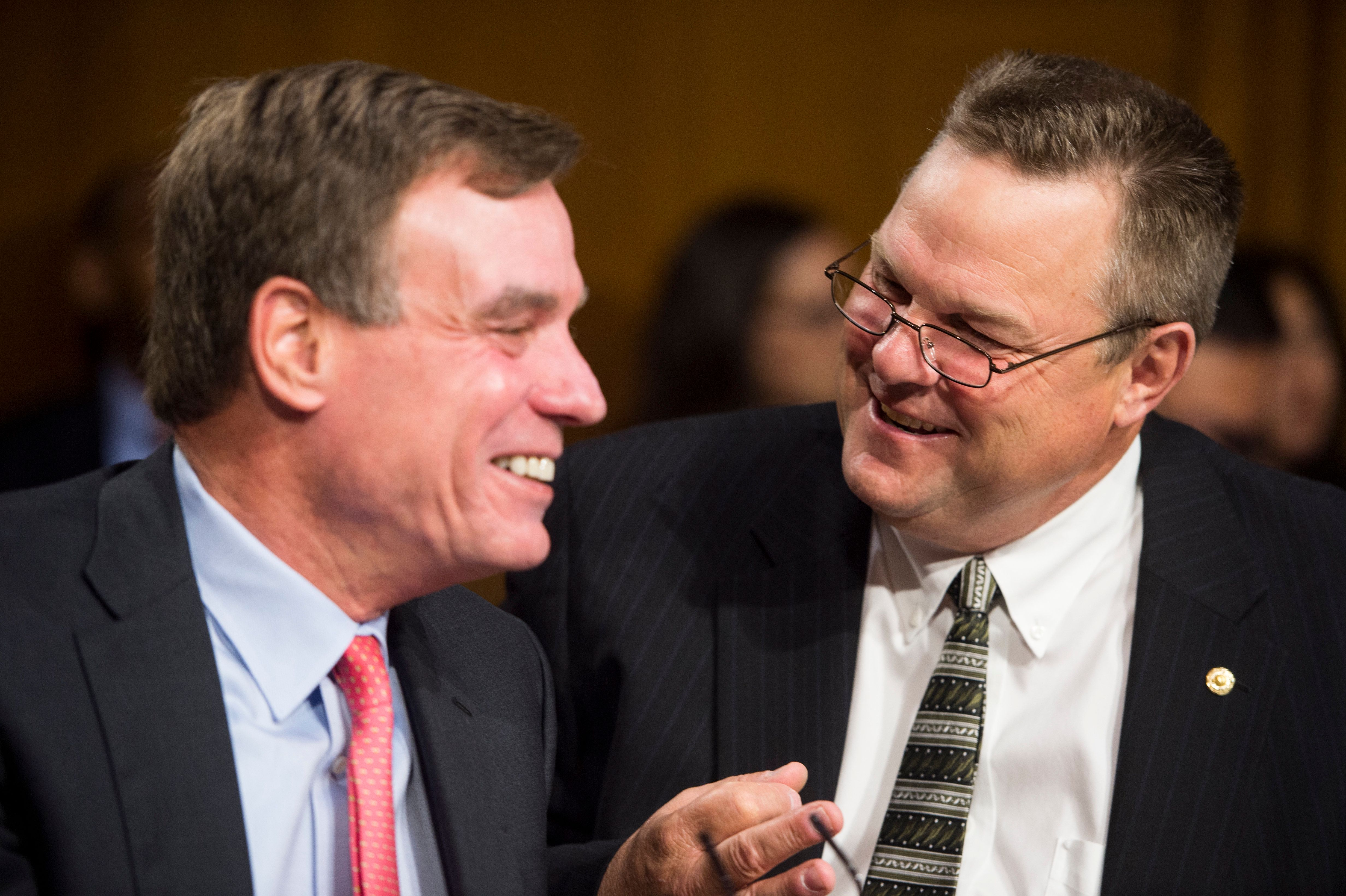 Democratic Sens. Mark Warner of Virginia, left, and Jon Tester of Montana areamong those backingthe nomination of