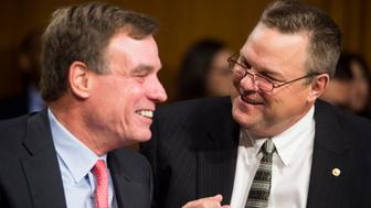 UNITED STATES - JULY 15: From left, Sen. Mark Warner, D-Va., and Sen. Jon Tester, D-Mont., talk before the start of the Senate Banking, Housing and Urban Affairs Committee hearing on 'The Semiannual Monetary Policy Report to the Congress' on Tuesday, July 15, 2014. (Photo By Bill Clark/CQ Roll Call)
