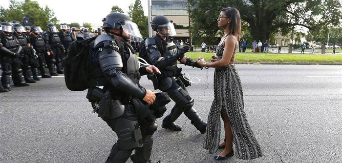 Black Lives Matter activist, Ieshia Evans, remaining calm while walking up to a line of riot police Baton Rouge, Louisiana.