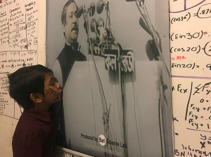 Isaac gives a kiss to the image of Bangabandu, the Father of Bangladesh, after listening his 7th March Speech.