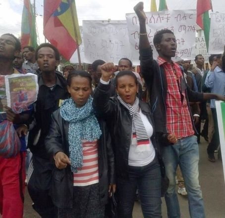 Ethnic Oromo students rally together as they demand the end of foreign land grabs marching with placards on the streets of Ad