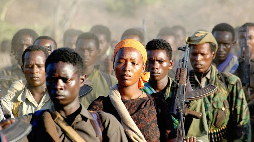 One lone woman stands out surrounded  by men during her march with Ethiopia'a Oromo Liberation Front (OLF), a national self-d