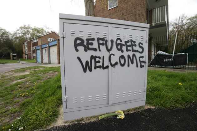 Police and community leaders were to visit the crime scene on Wednesday; graffiti saying 'refugees welcome'...