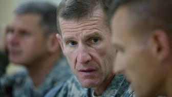 FORWARD OPERATING BASE WALTON, AFGHANISTAN - OCTOBER 7:  ISAF Commander General Stanley A. McChrystal (C) meets with high ranking military personnel October 7, 2009 at the forward operating base (FOB) Walton, outside of Kandahar, Afghanistan. The 55-year-old U.S Army top commander of U.S. forces in Afghanistan has reportedly rankled U.S. President Barack Obama and the White House after he made an appeal for more U.S. troops in Afghanistan and publicly differed with the administration. (Photo by Paula Bronstein/Getty Images)