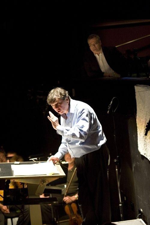 """Daron Hagen observes as Gerard Schwarz rehearses his opera """"Amelia"""" at Seattle Opera."""