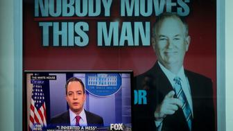 NEW YORK, NY - FEBRUARY 17: White House Chief of Staff Reince Priebus is interviewed on 'Fox And Friends', seen on a monitor outside of the Fox News studios, on February 17, 2017 in New York City. President Trump, a frequent consumer and critic of cable news, recently tweeted that Fox and Friends is 'great'. Behind the monitor is an advertisement for Fox News personality Bill O'Reilly. (Photo by Drew Angerer/Getty Images)