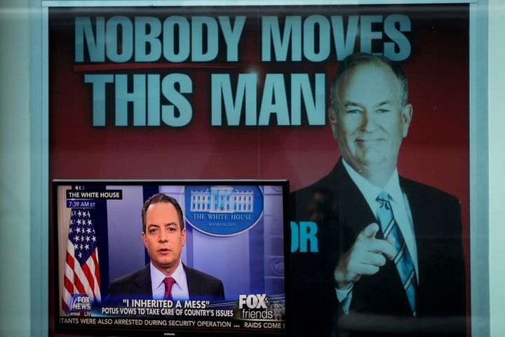 An advertisement for Fox News star Bill O'Reilly hangs outside the network's studio in New York City.
