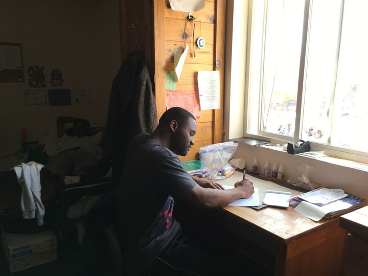 Anthony Green writes a letter in his room at Gaudenzia, a drug and alcohol treatment center in Baltimore. Maryland is one of