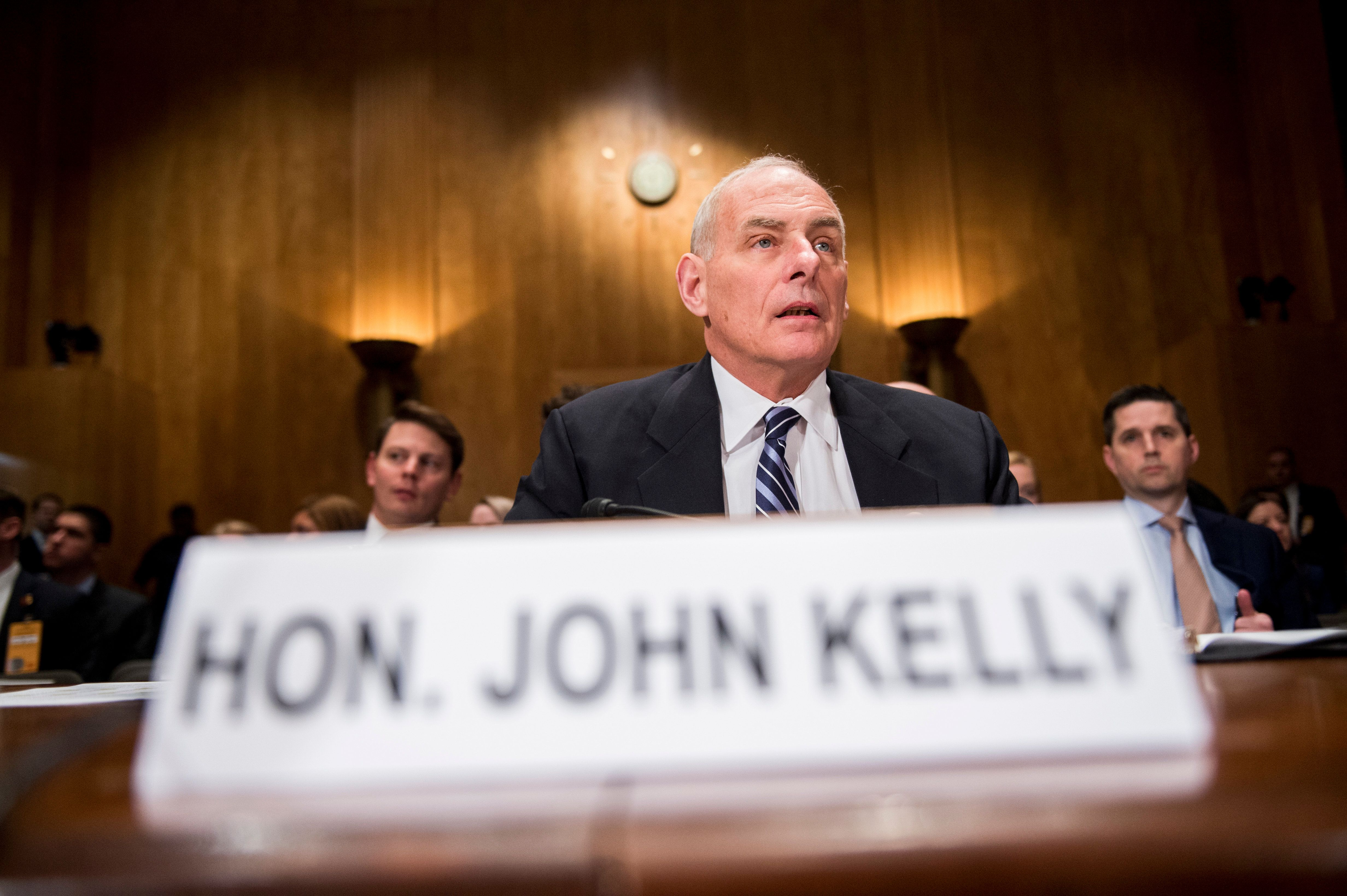 UNITED STATES - APRIL 5: Secretary of Homeland Security John Kelly prepares to testify during the Senate Homeland Security and Governmental Affairs Committee hearing on 'Improving Border Security and Public Safety' on Wednesday, April 5, 2017. (Photo By Bill Clark/CQ Roll Call)