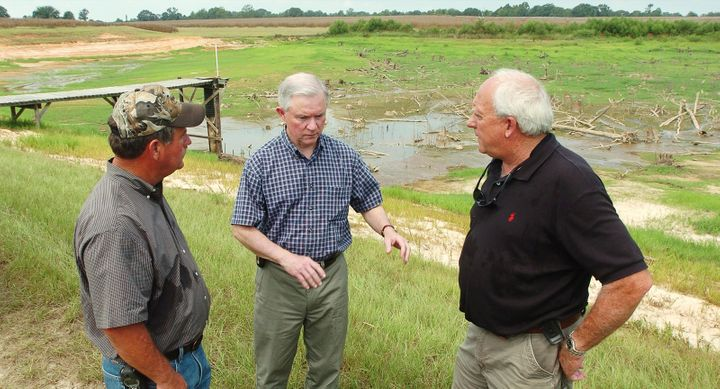 U. S. Senator Jeff Sessions, center, speaks with Alabama farmers on November 29, 2007.