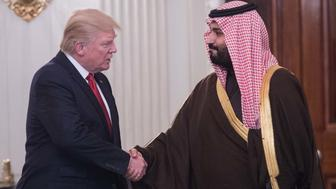 US President Donald Trump and Saudi Deputy Crown Prince and Defense Minister Mohammed bin Salman shake hands in the State Dining Room before lunch at the White House in Washington, DC, on March 14, 2017. Trump welcomed the prince to the Oval Office, as both countries expect to improve ties that were frequently strained under Barack Obama's administration. Saudi Arabia is likely to welcome Trump's harder line on its arch-rival Iran and there is likely to be less friction over Riyadh's war against Iranian-backed Huthi rebels in Yemen.  / AFP PHOTO / NICHOLAS KAMM        (Photo credit should read NICHOLAS KAMM/AFP/Getty Images)