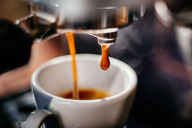 Espresso pours out of a