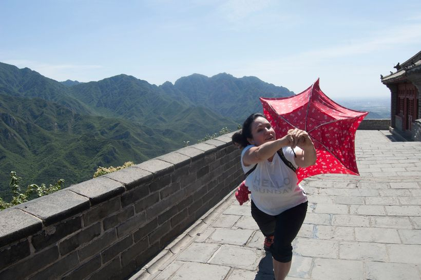 Hiking the Great Wall of China with a flimsy umbrella