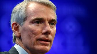 """U.S. Senator Rob Portman (R-OH) speaks during a session called """"The New Congress"""" at the Wall Street Journal's CEO Council meeting in Washington December 2, 2014. REUTERS/Kevin Lamarque/File Photo"""
