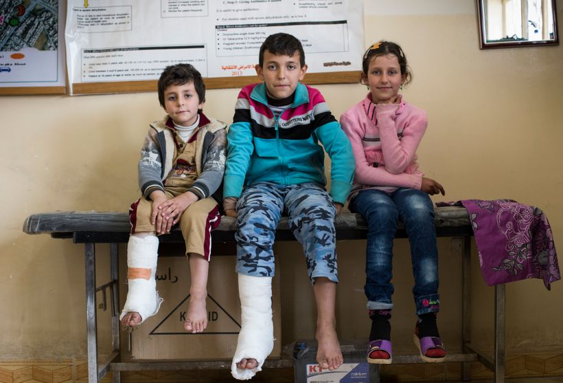 From left: Ahmed Wissan Thanoon, 6, Mohmed Wissan Thanoon, 11, and Zahra Wissan Thanoon, 9, at the primary heatlh care clinic