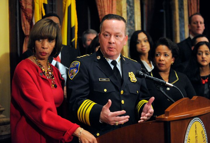 Baltimore City Police Commissioner Kevin Davis, along with Mayor Catherine E. Pugh and former Attorney General Loretta E