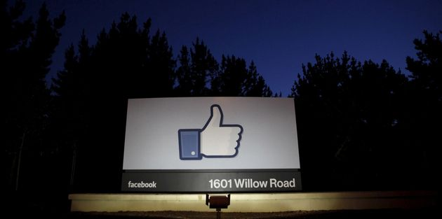 The sun rises behind the entrance sign to Facebook headquarters in 2012 in this file photo. Facebook...