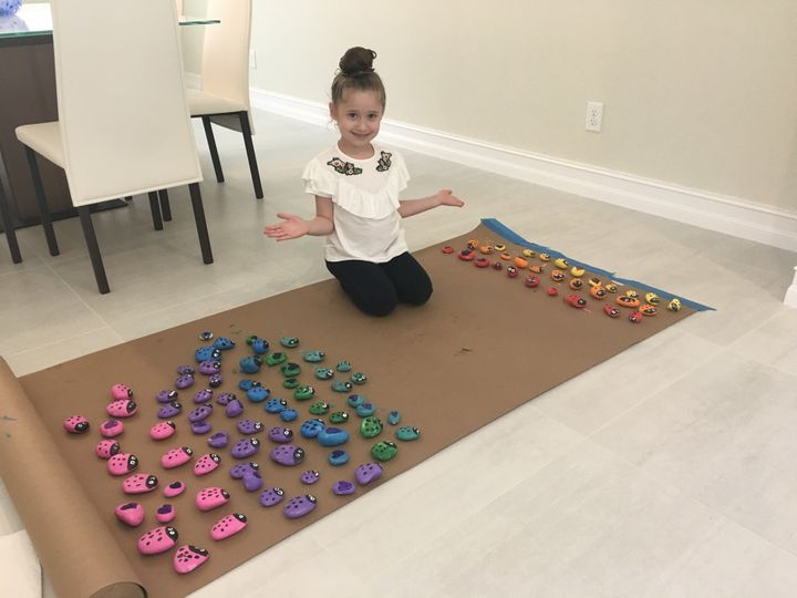 "Ayel's mom said the 6-year-old has painted ""hundreds of rocks"" for her project."