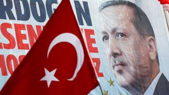 A huge banner with a picture of Turkish President Tayyip Erdogan is seen on a building during a ceremony in Istanbul, Turkey, March 26, 2017. REUTERS/Murad Sezer