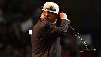 CHARLESTON, WV - MAY 5: Republican presidential candidate Donald Trump wears a coal miner's protective hat while addressing his supporters during a rally at the Charleston Civic Center on May 5, 2016 in Charleston, WV. (Photo by Ricky Carioti/The Washington Post via Getty Images)